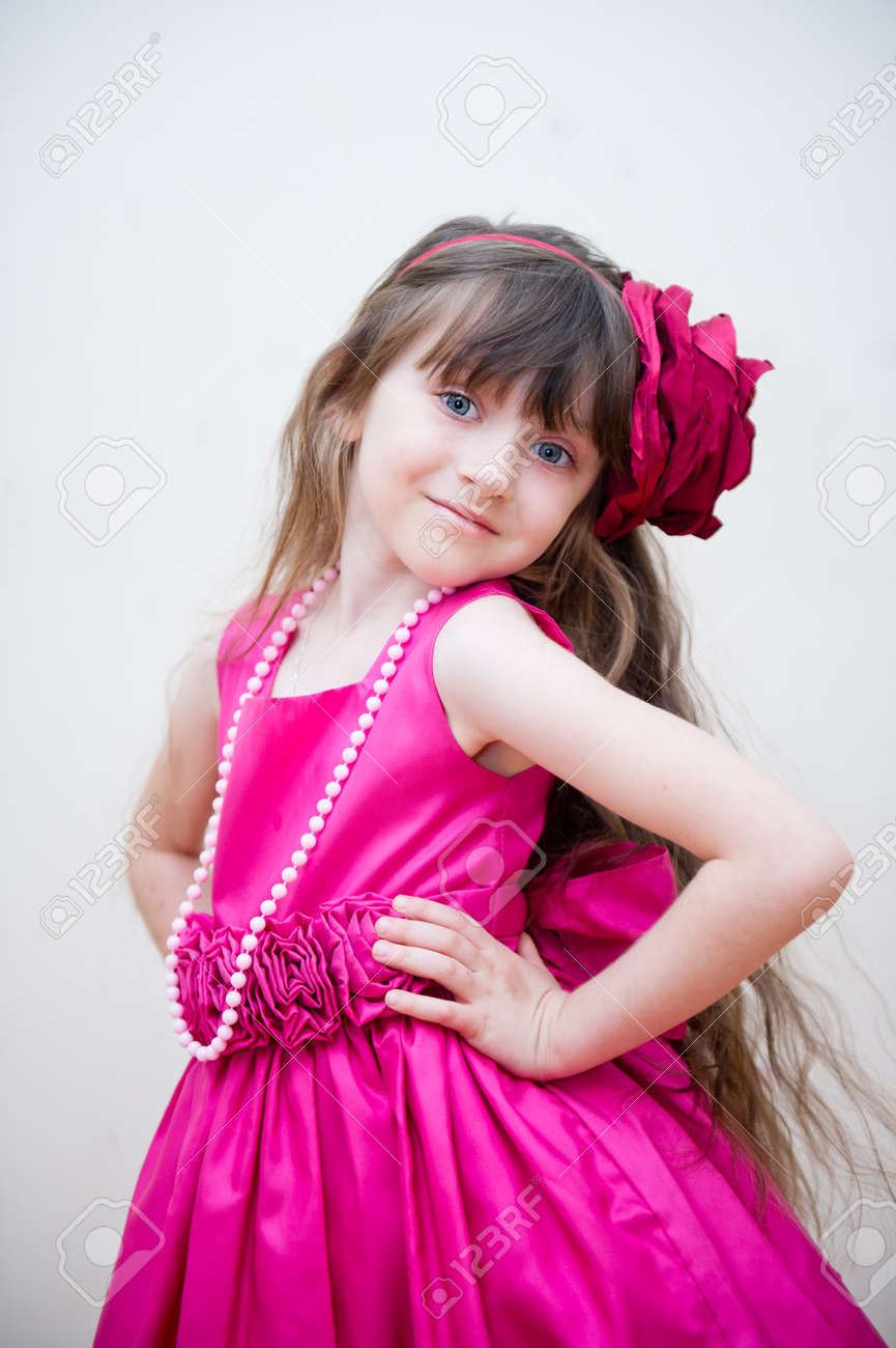 5dacf5330473 Pretty little girl in beautiful pink dress with flower headband, isolated  Stock Photo - 11488654