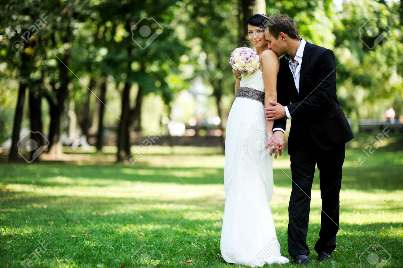 Elegant bride and groom posing together outdoors on a wedding day Stock Photo - 11929551