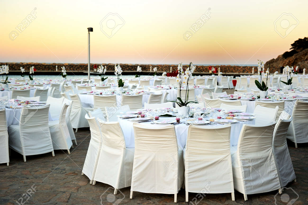Table Set Up For A Wedding Ceremony On Beach Resort Stock Photo
