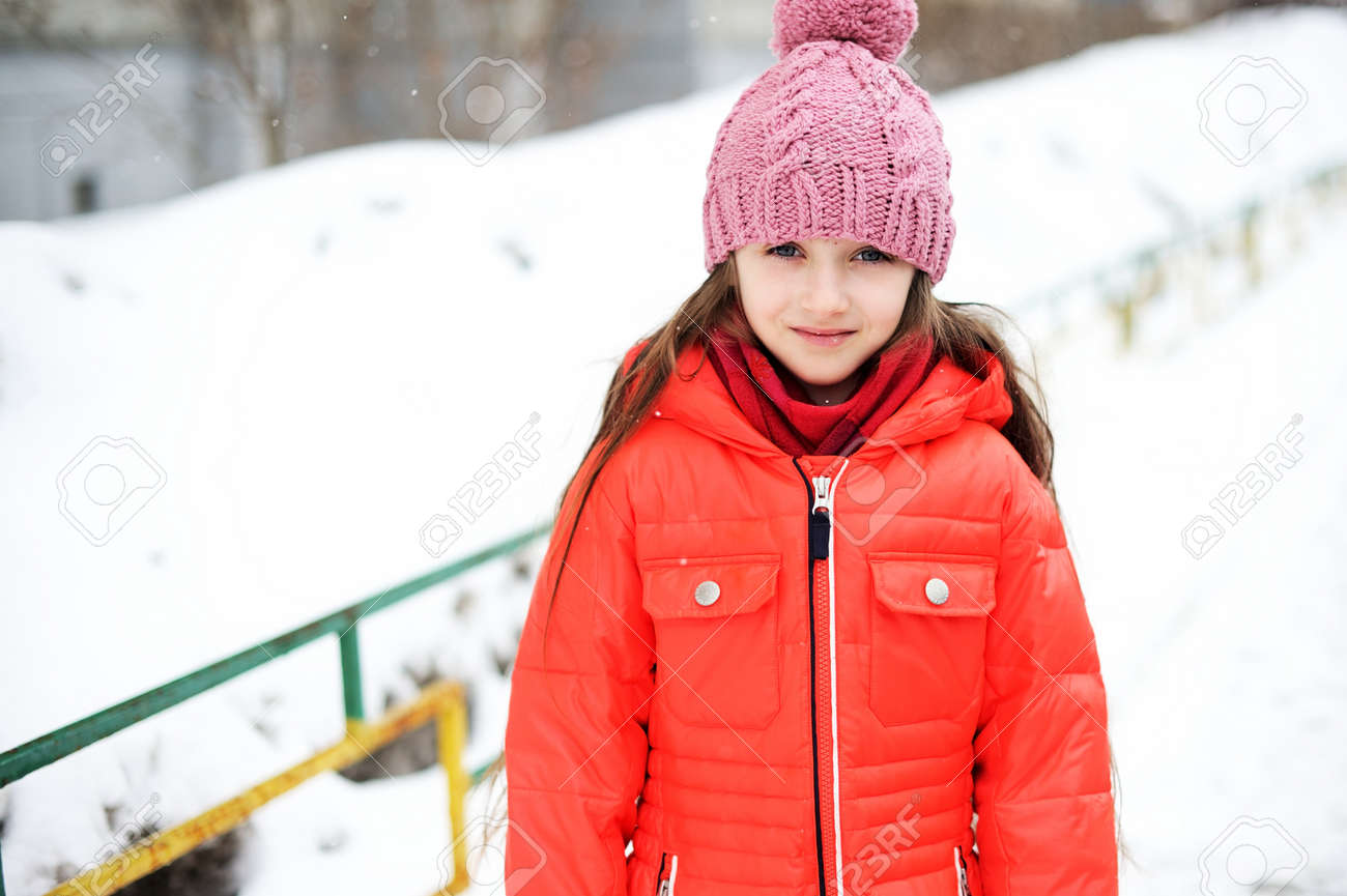 422c60f37 Portrait Of Child Girl In Red Winter Jacket And Pink Hat Stock Photo ...