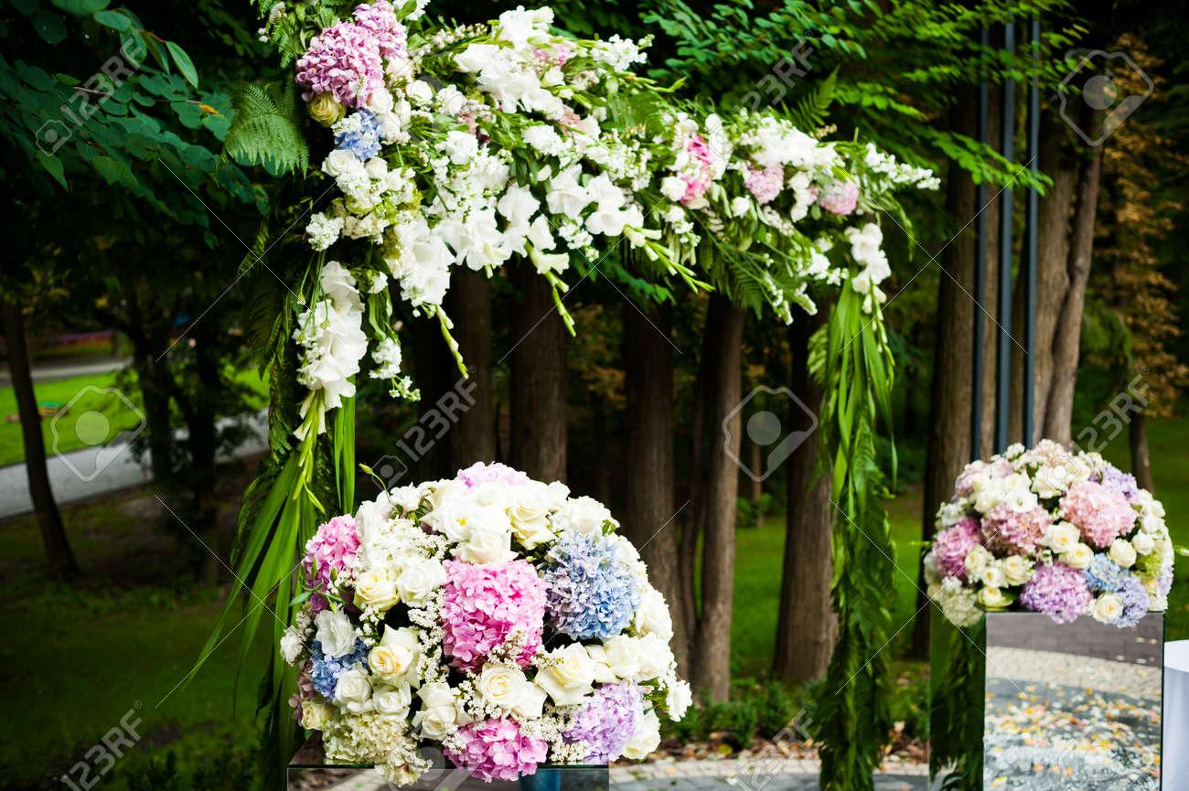 Beautiful wedding decorations wedding arch with bouquets for beautiful wedding decorations wedding arch with bouquets for ceremony stock photo 105402902 junglespirit Gallery