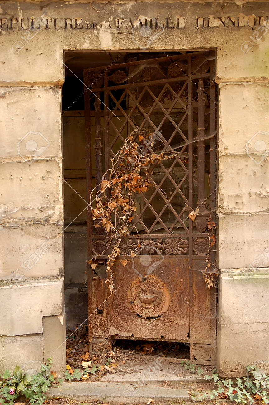 Old ornate iron door. Entrance to an old tomb crypt at a cemetery. & Old Ornate Iron Door. Entrance To An Old Tomb Crypt At A Cemetery ...