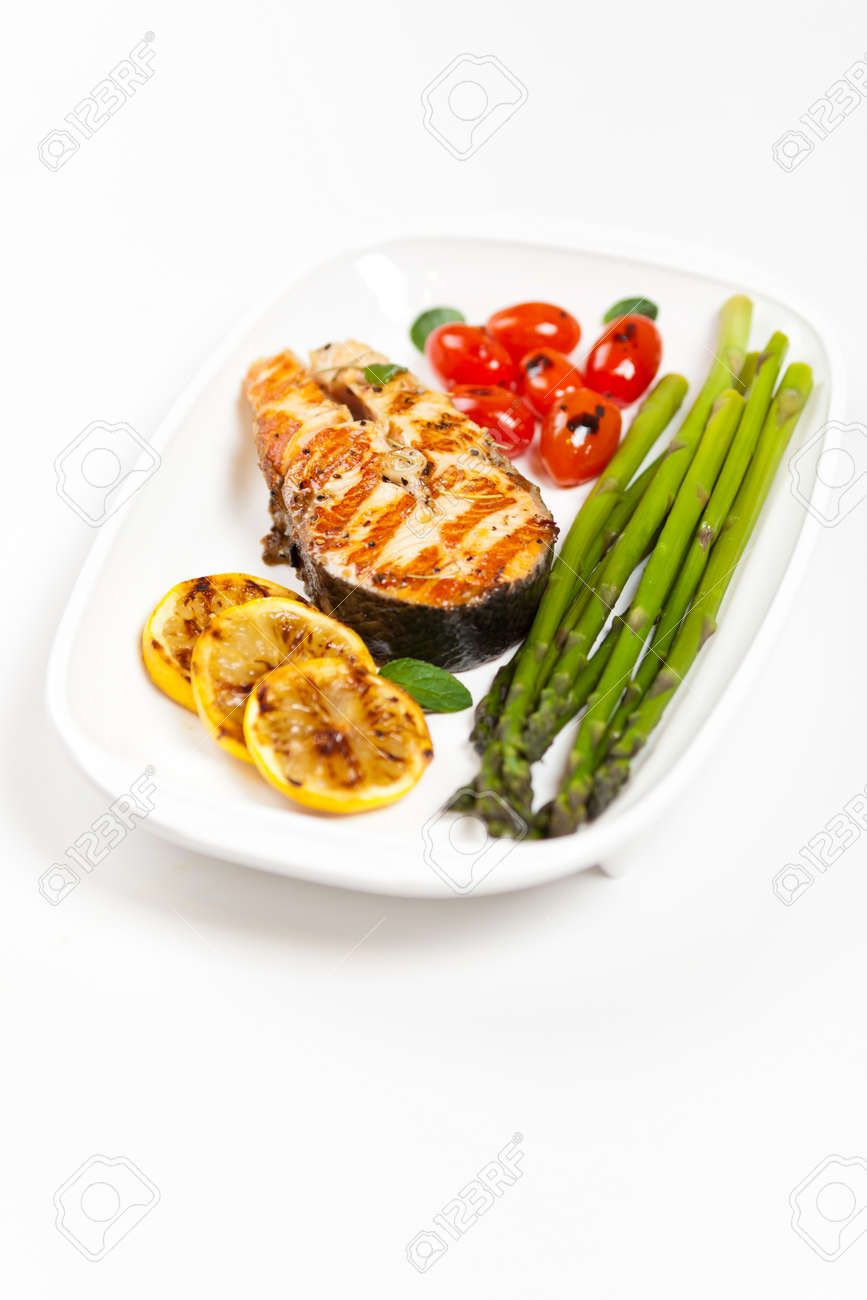 Grilled salmon steak with asparagus and cherry tomatoes Stock Photo - 19638514