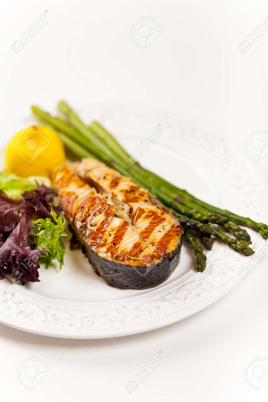 Grilled salmon steak with asparagus, lemon and salad Stock Photo - 19806507