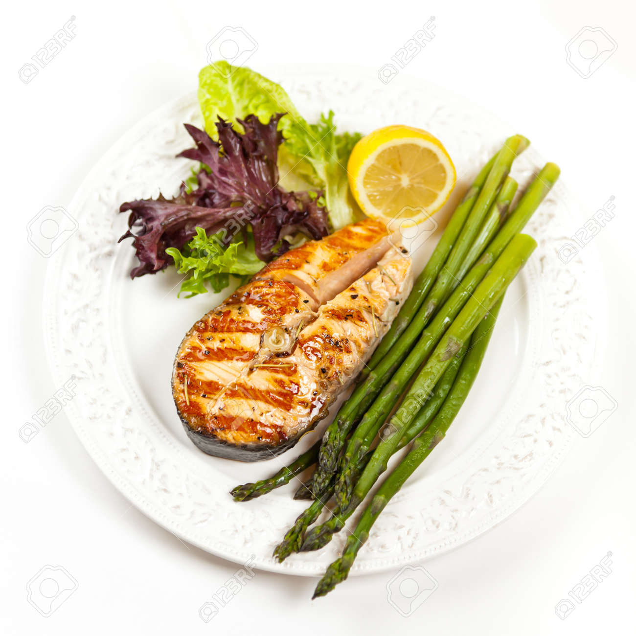 Grilled salmon steak with asparagus, lemon and salad Stock Photo - 19806470