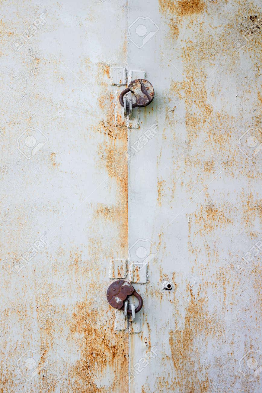 two locks on an iron rusty door Stock Photo - 22031192