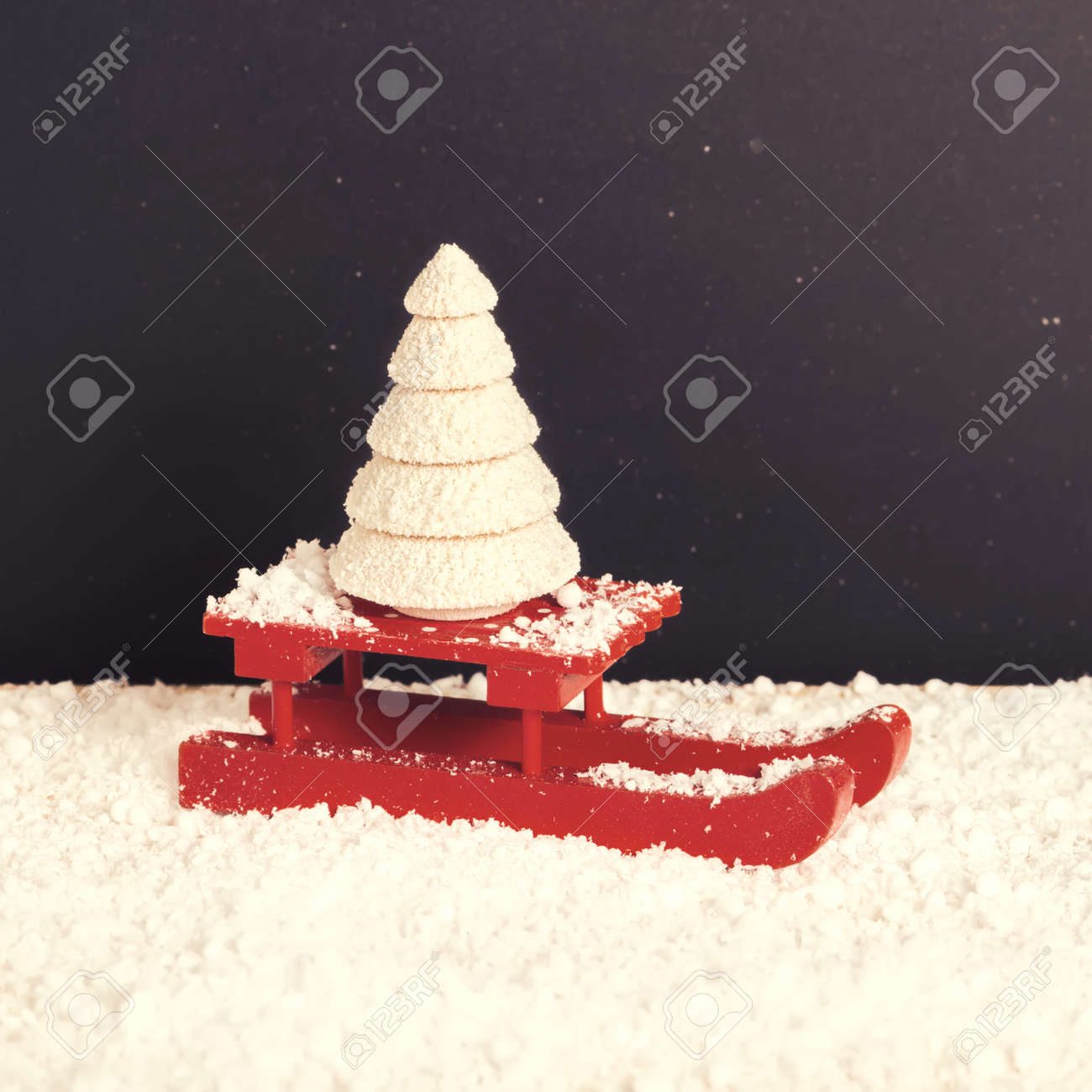 Red Festive Sled With Spruce Tree In Snow On Chalkboard Background