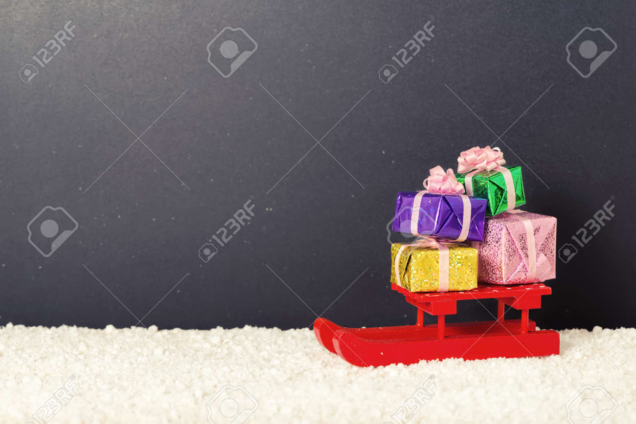 Red Festive Sled With Full Gift Boxes In Snow On Chalkboard