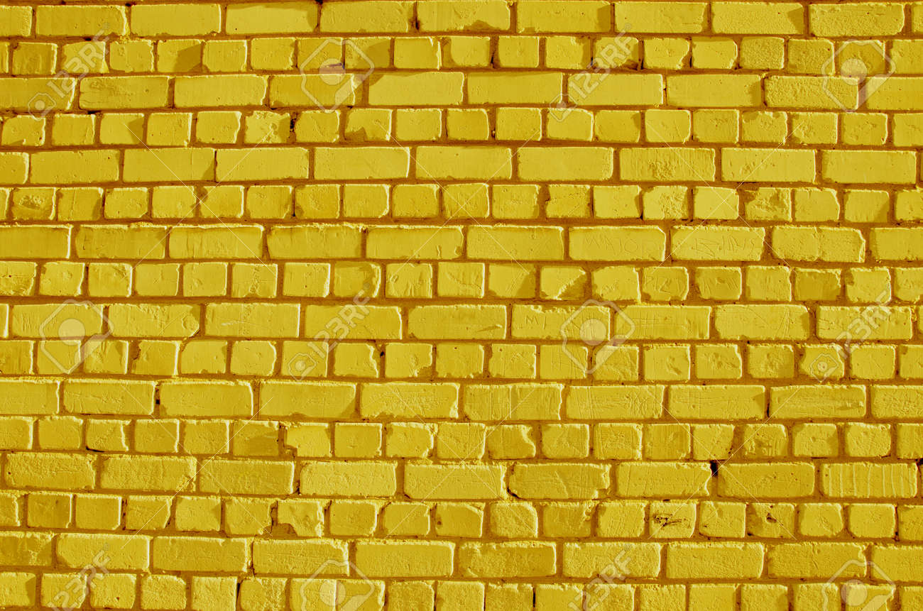 painted bricks yellow wall background and texture - 11327072