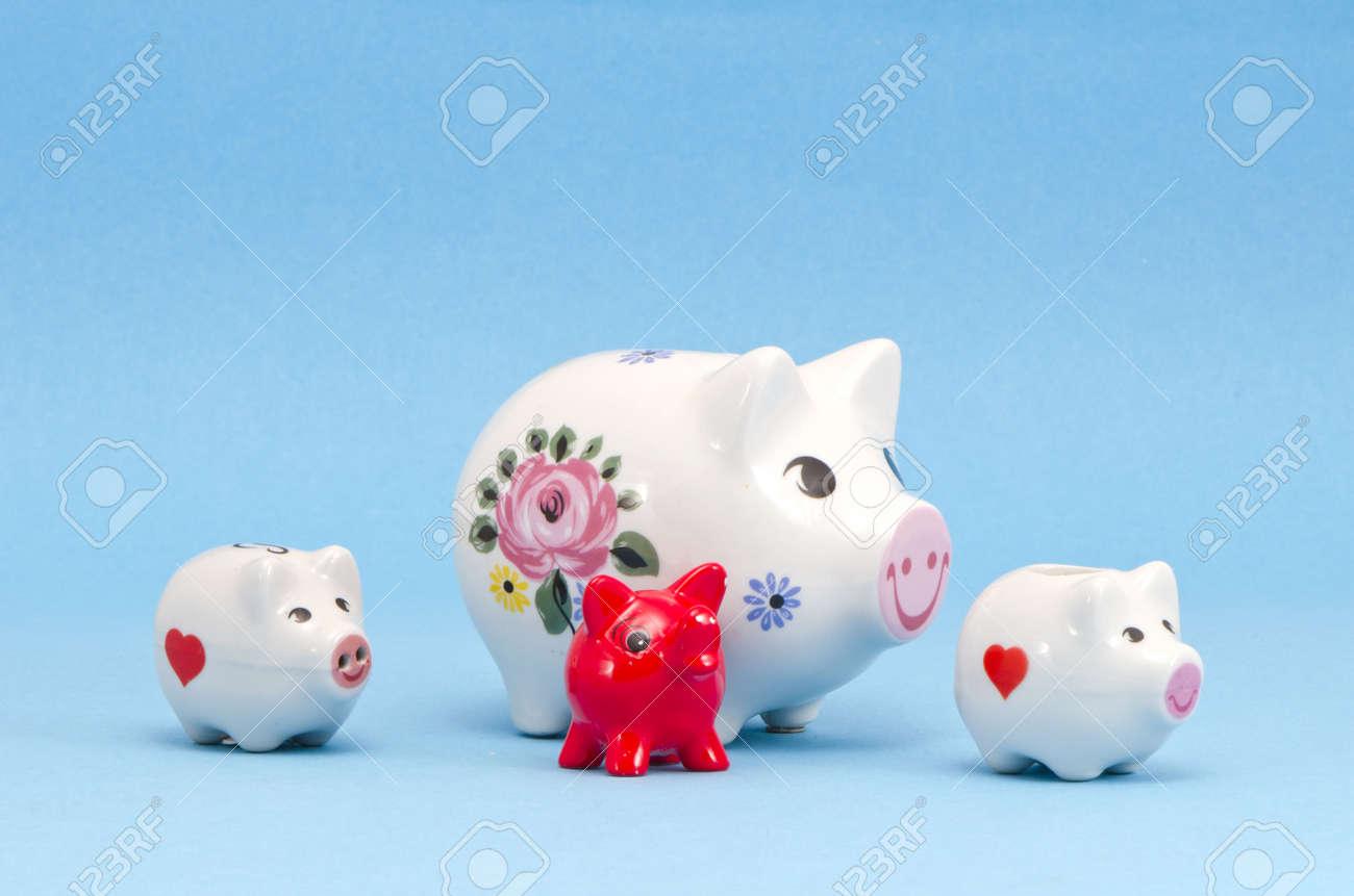 various four piggy-banks on azure background Stock Photo - 13024204
