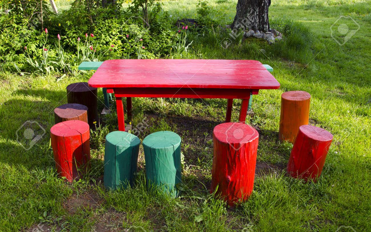 colorful rural garden furniture in springtime - 13898211