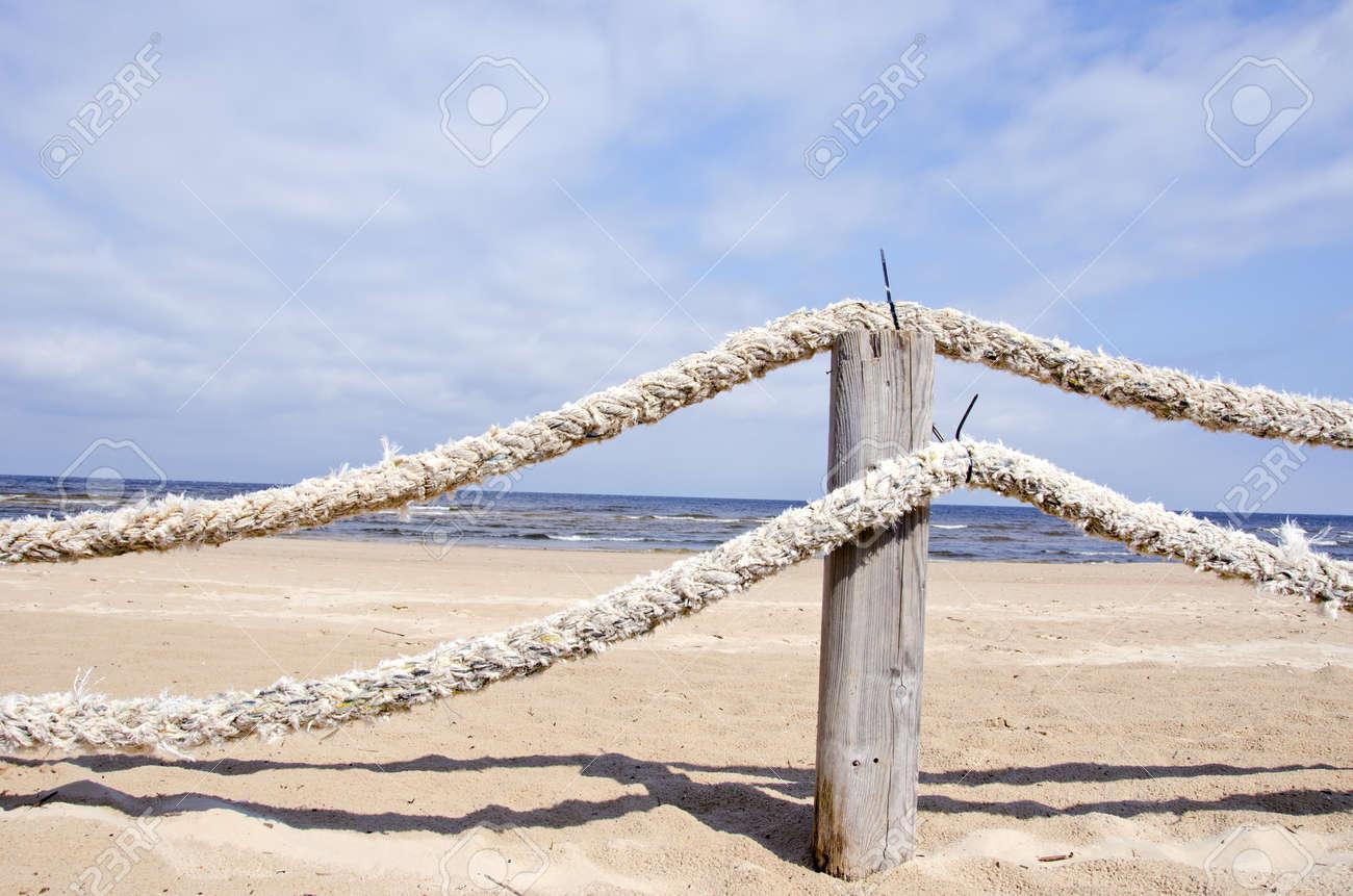 old ropes fence on resort beach nea sea - 15741463