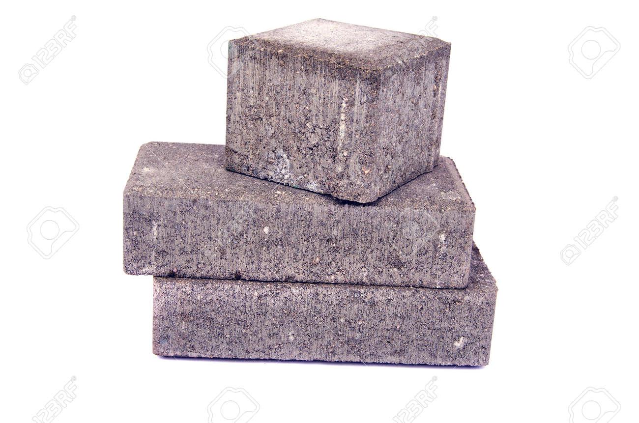 new gray decorative street pavement concrete bricks paving stone isolated on white background - 35938576