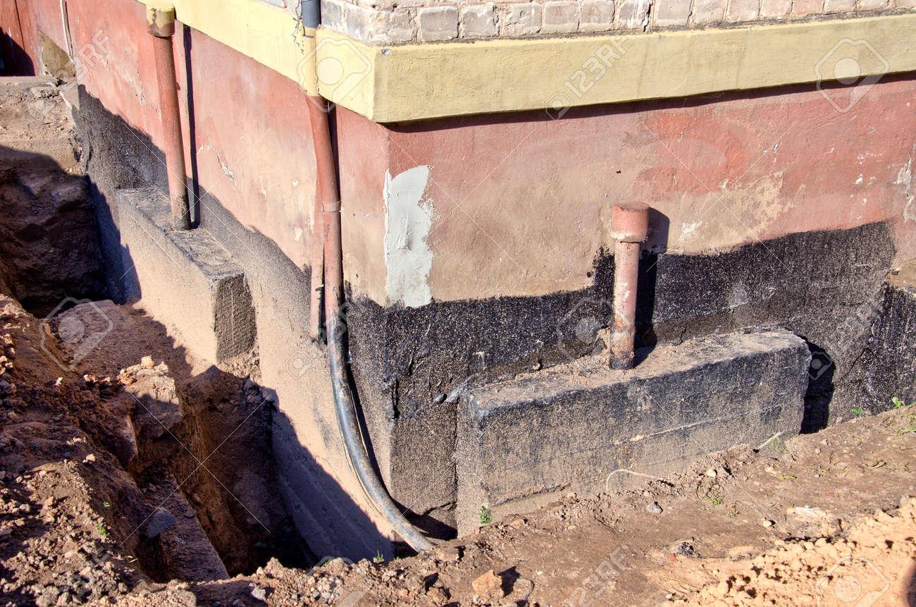 repair old urban house foundation - 36943473