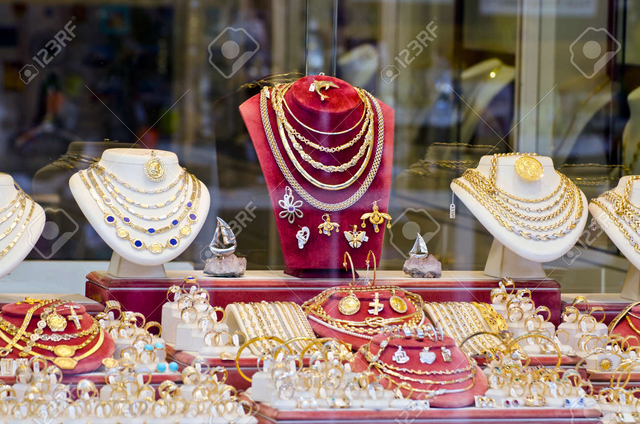 Display of various jewelry in store window - 49750275