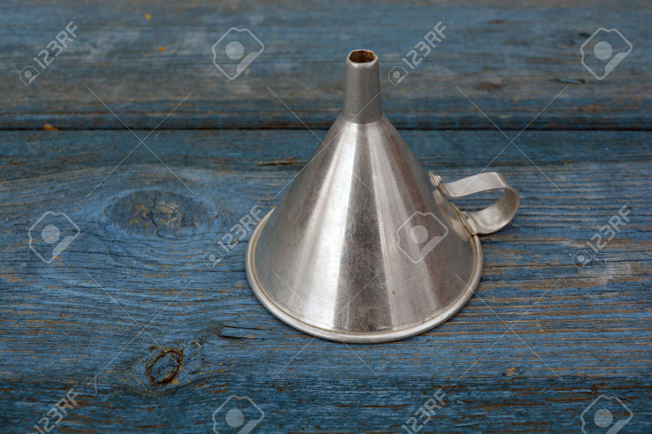 Retro Metal Funnel With Handle On Old Wooden Blue Garden Table ...