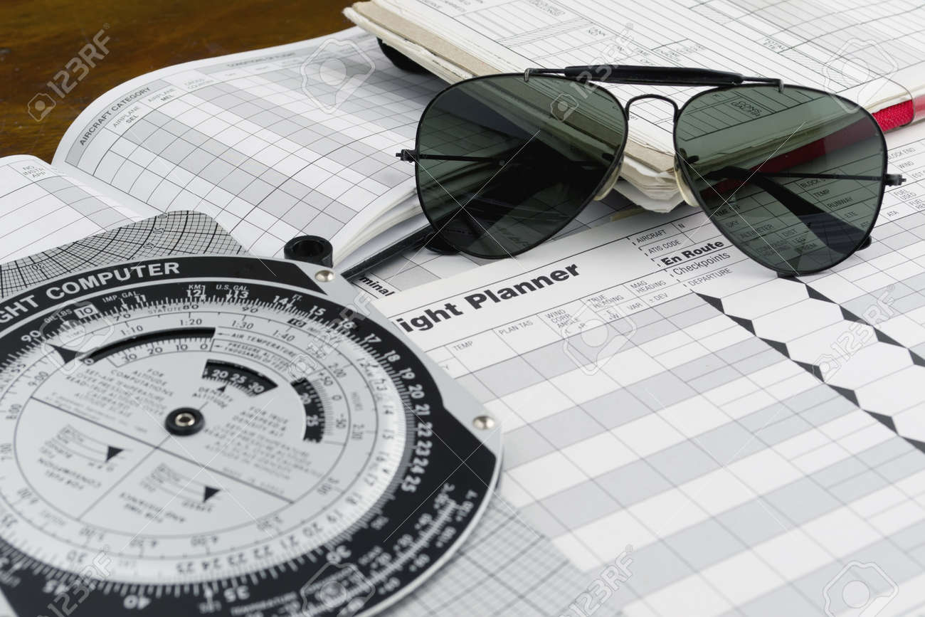 pilot style sunglasses on a flight plan paper