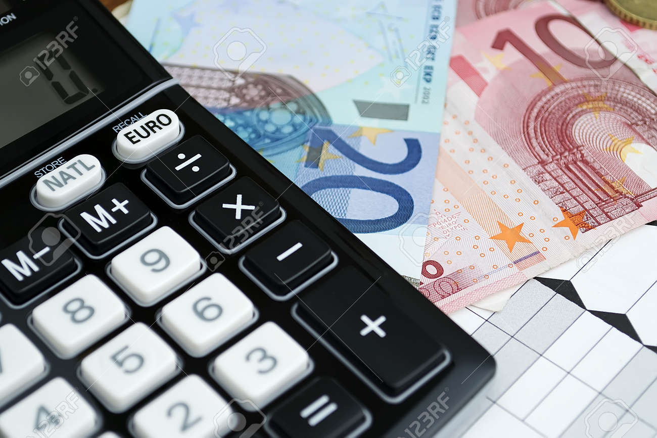 euro converter with euros bills and coins on a paper - 11641697