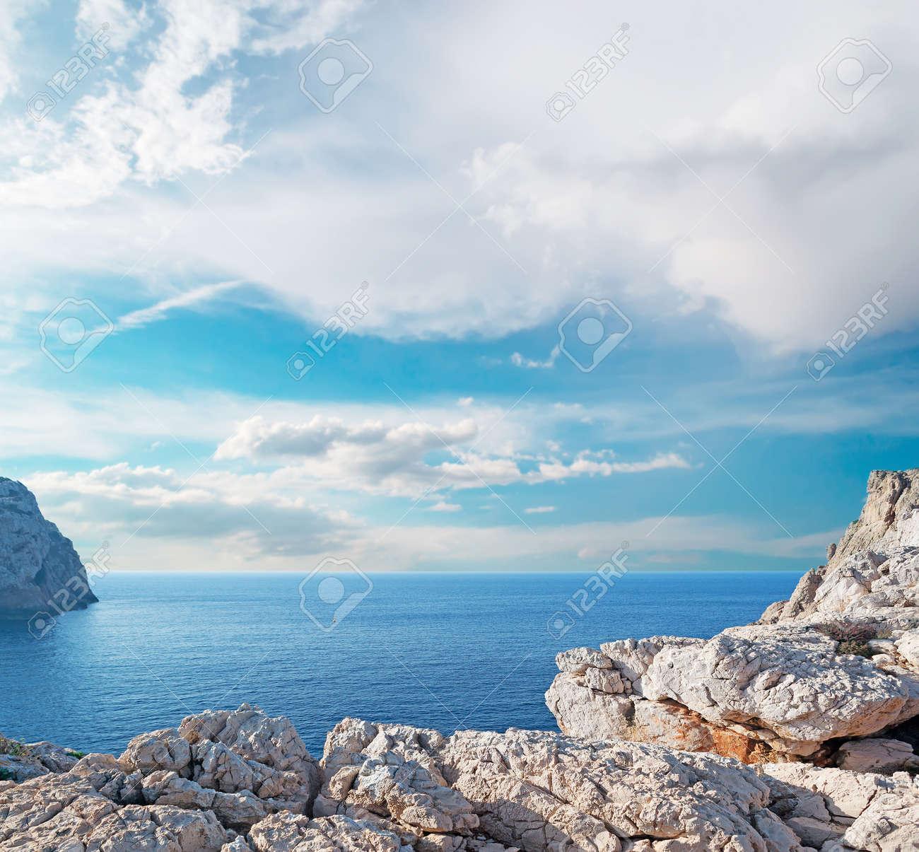 Capo Caccia coastline on a cloudy day - 24419783