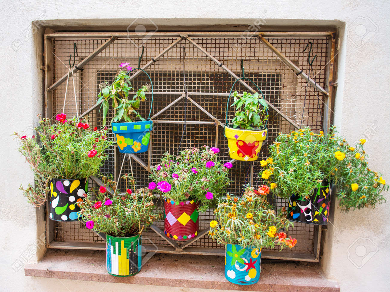 Colorful Flower Pots In A Rustic Wall Stock Photo Picture And Royalty Free Image Image 32386333
