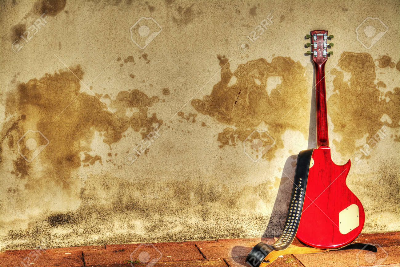 Rear View Of An Electric Guitar Leaned On A Rustic Wall In Hdr ...