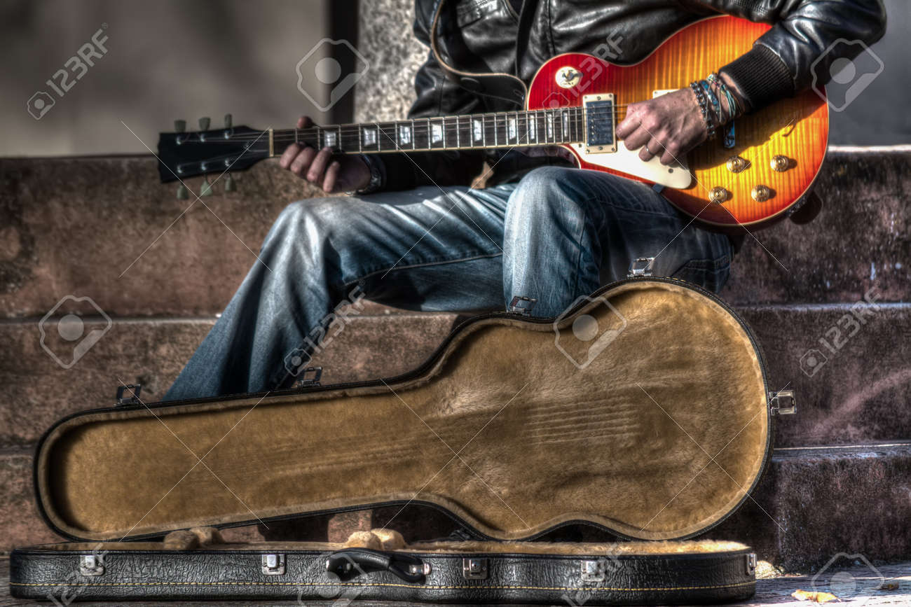 guitar player with an open guitar case in hdr - 38151532