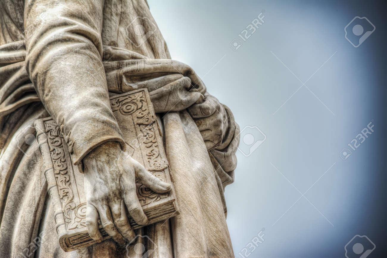 close up of Dante Alighieri statue in Florence, Italy - 47330399