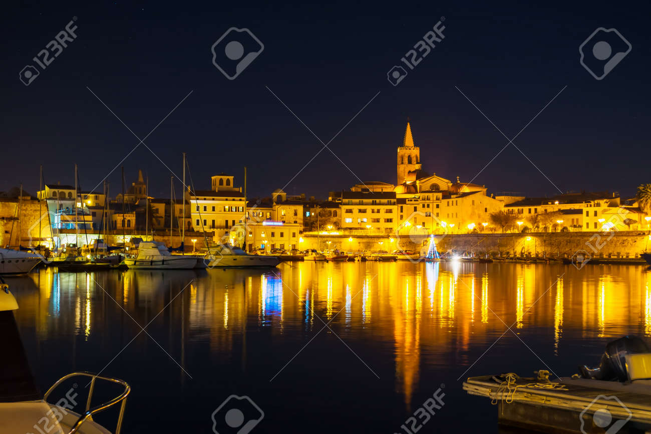 Alghero cityscape under a clear sky at night, Italy - 55874246