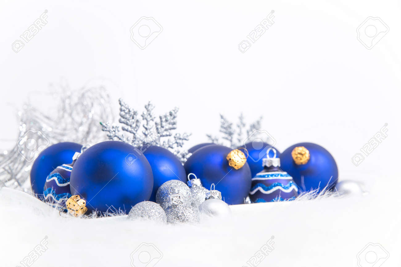 Arrangement Of Blue Christmas Ornaments On Tray With White Background