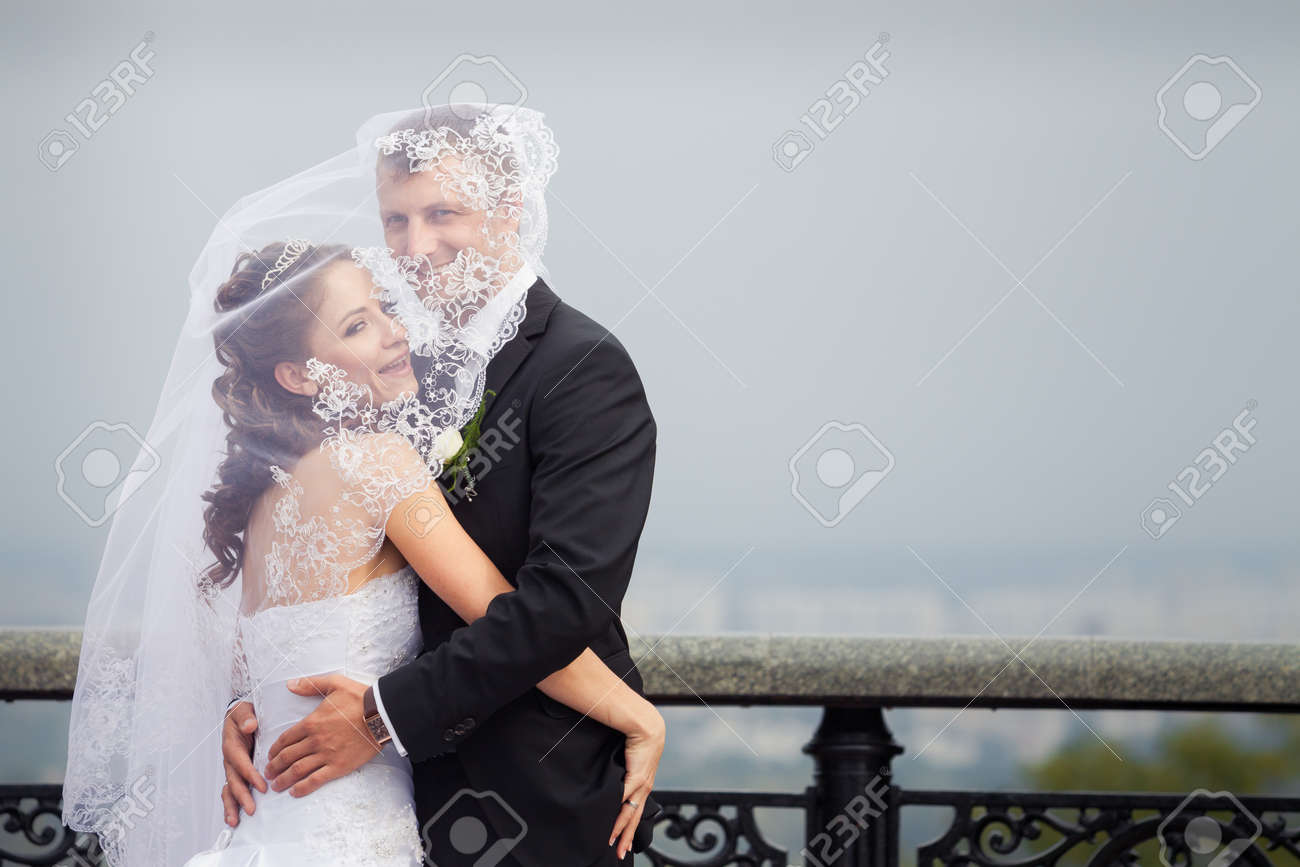 Beautiful Brunette Bride In White Wedding Dress And Young Handsome ...