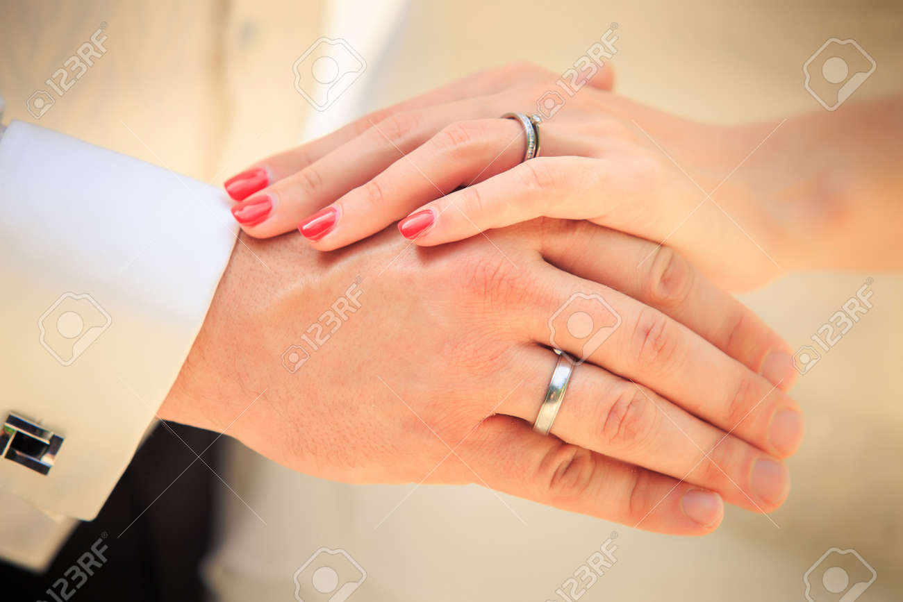 bride and groom hands with golden rings clouseup - 51733947