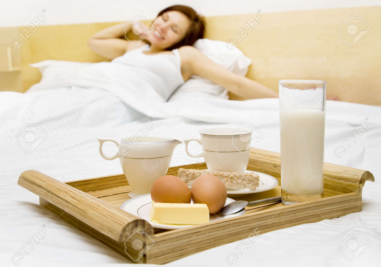 Young woman has a breakfast in the bed Stock Photo - 4121109