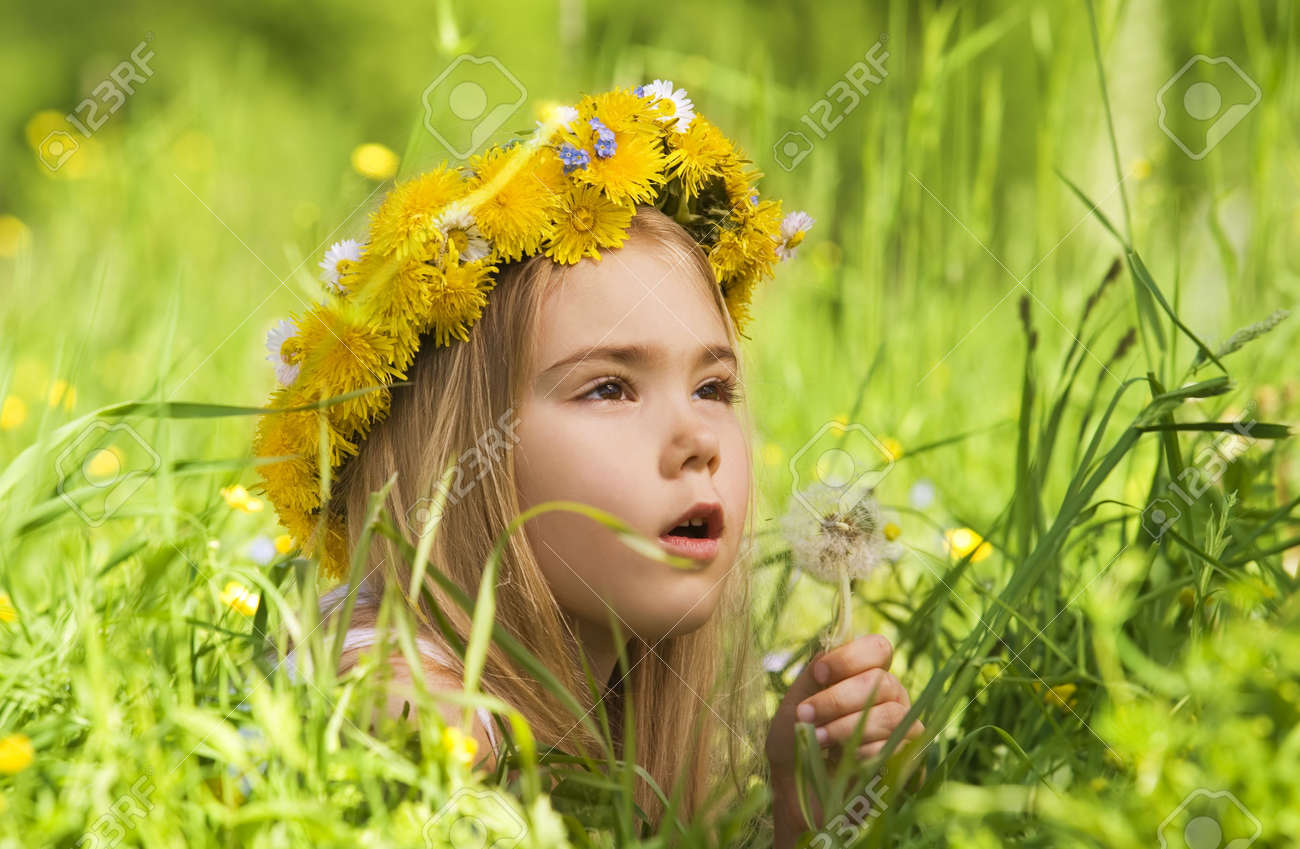 Portrait of a little girl in the grass Stock Photo - 4964362