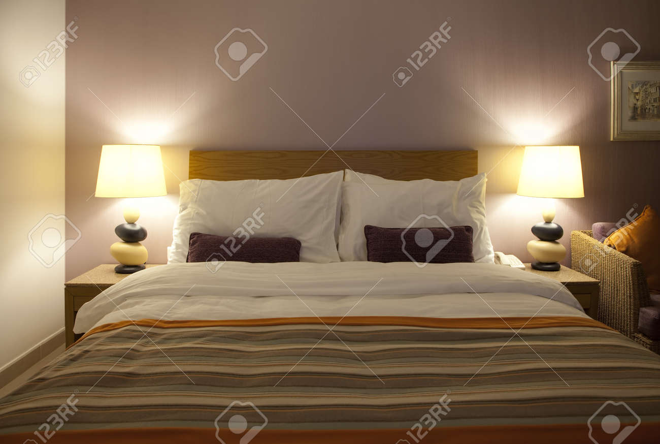 Well decorated hotel bedroom in soft lights Stock Photo - 8647829
