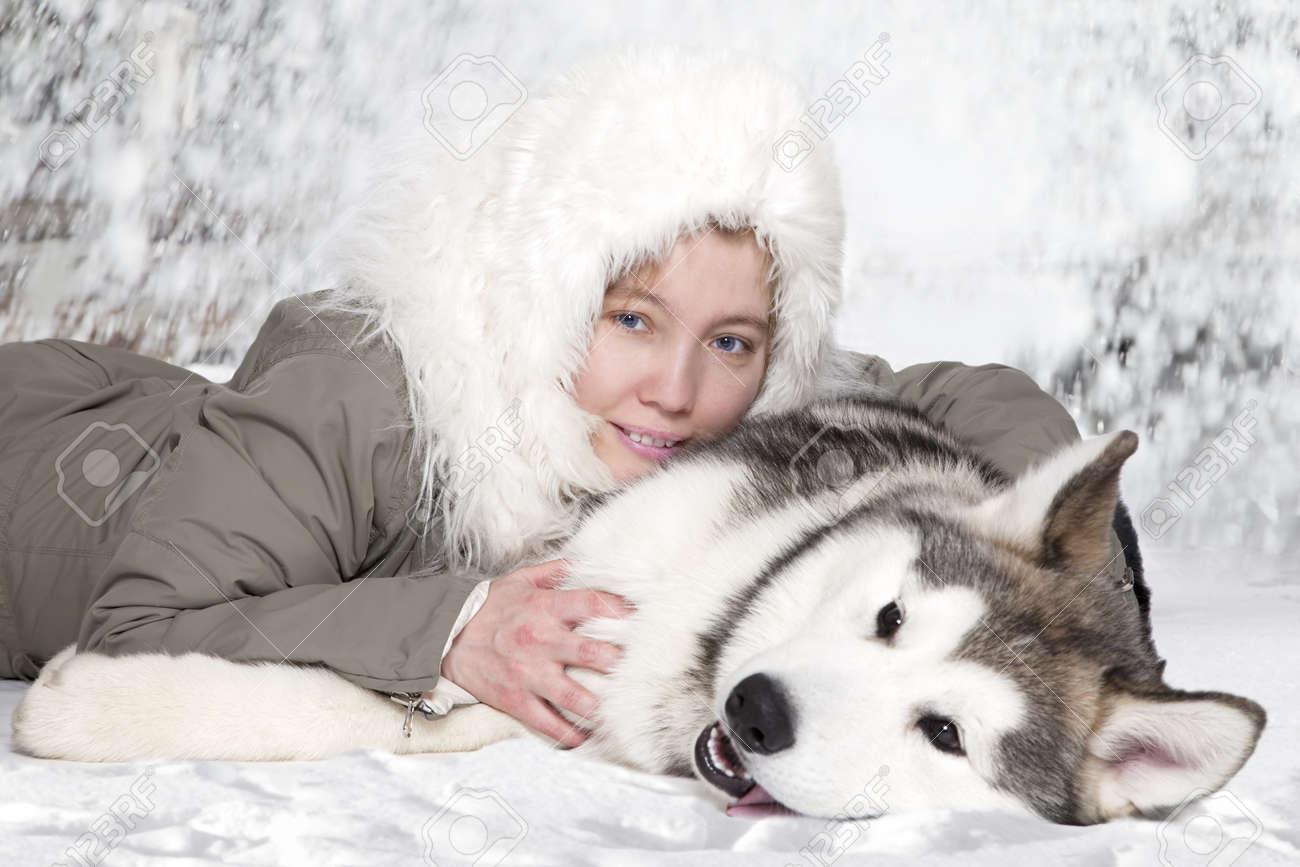 Five month old malamute puppy with young caucasian woman - 13048021