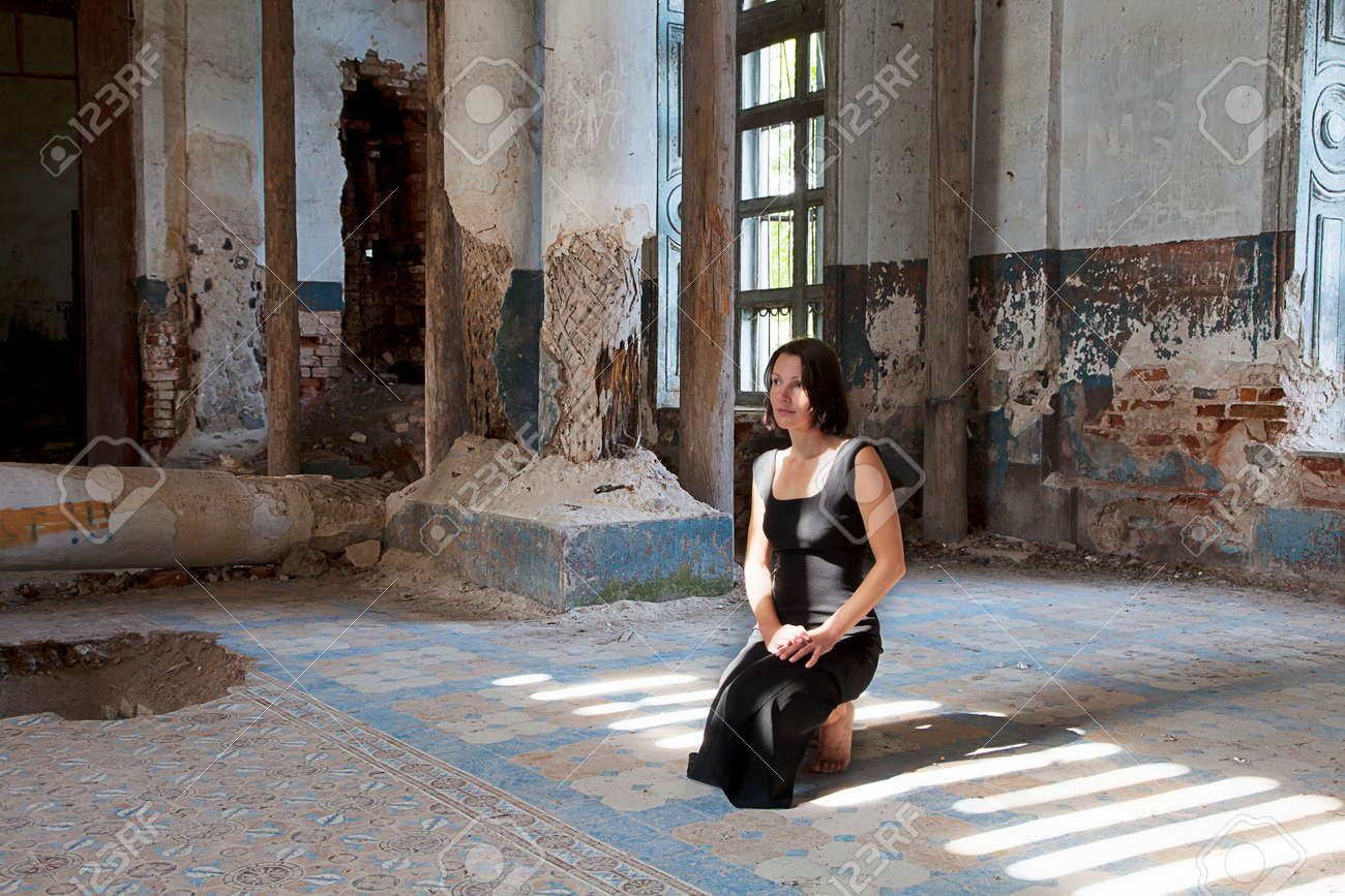 Abandoned Church young woman praying in old abandoned church stock photo, picture