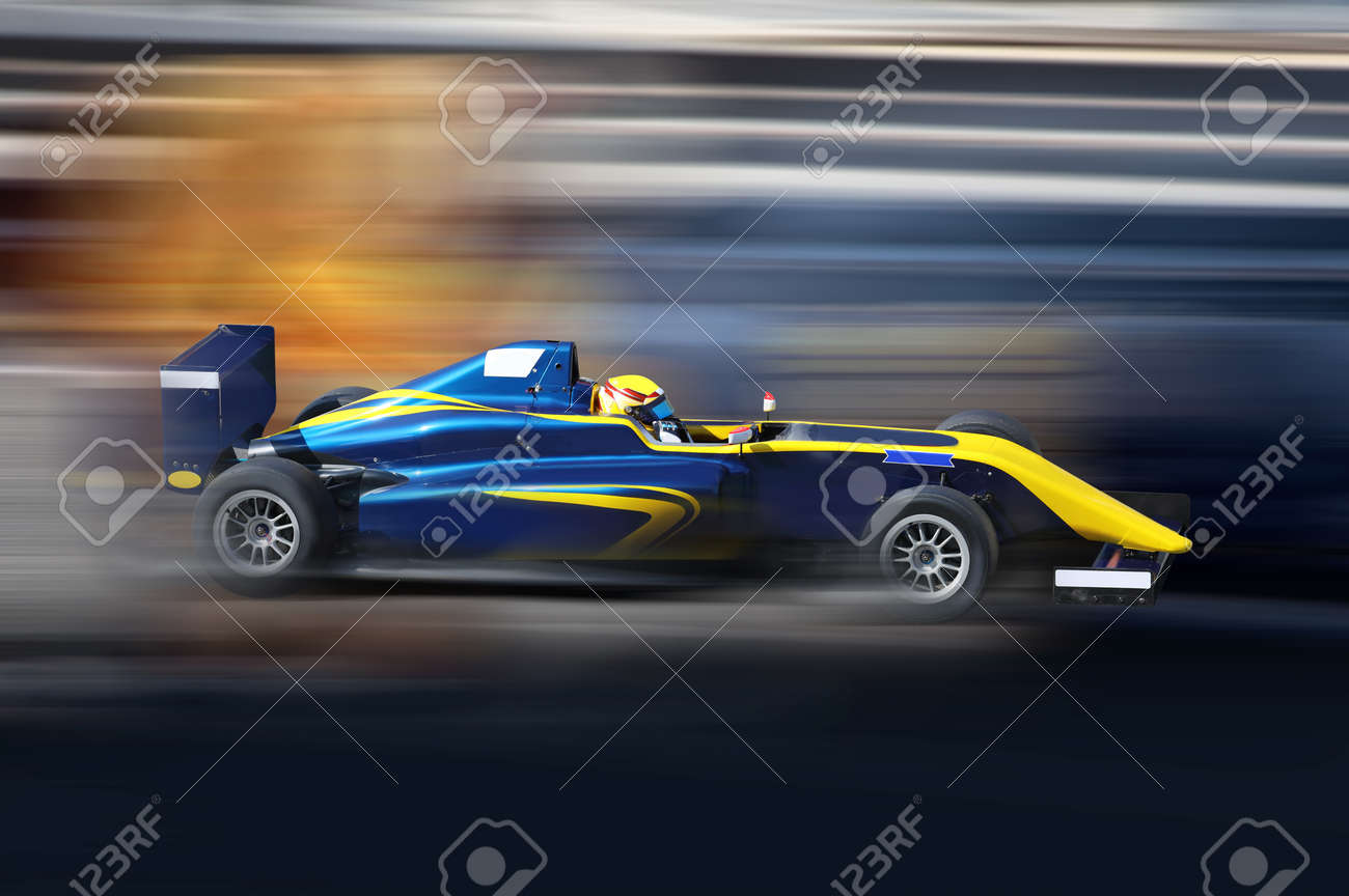 Formula 4.0 race car racing at high speed on speed track with motion blur - 88641827