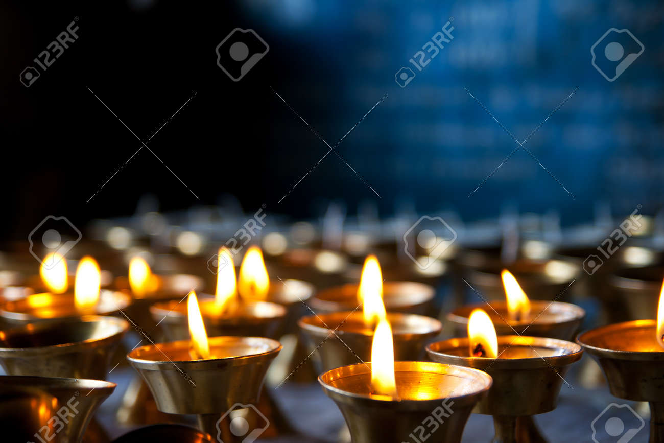 Burning candles in sconces on black blue background Stock Photo - 10201188