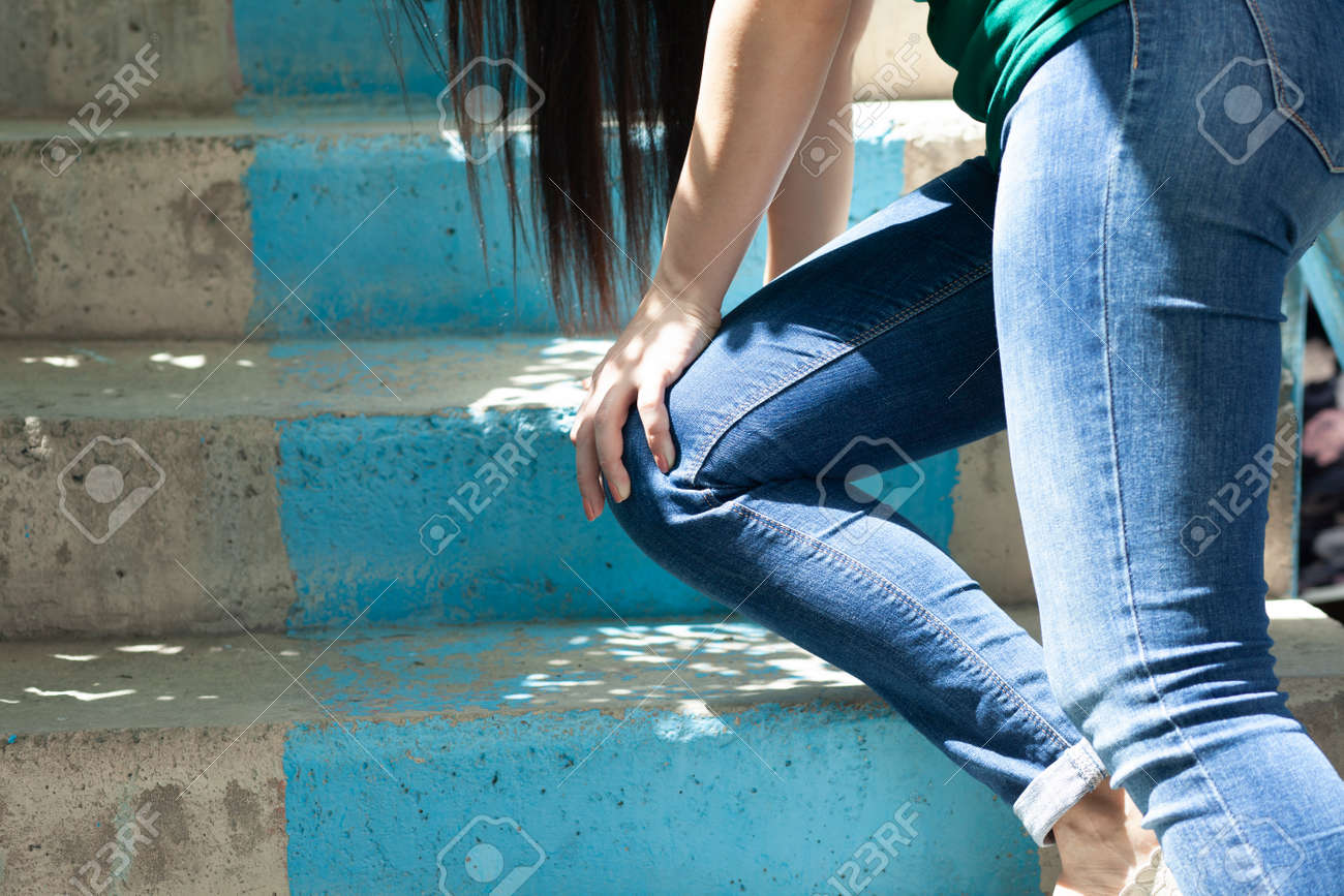 young woman fall on the blue stairs - 148340799