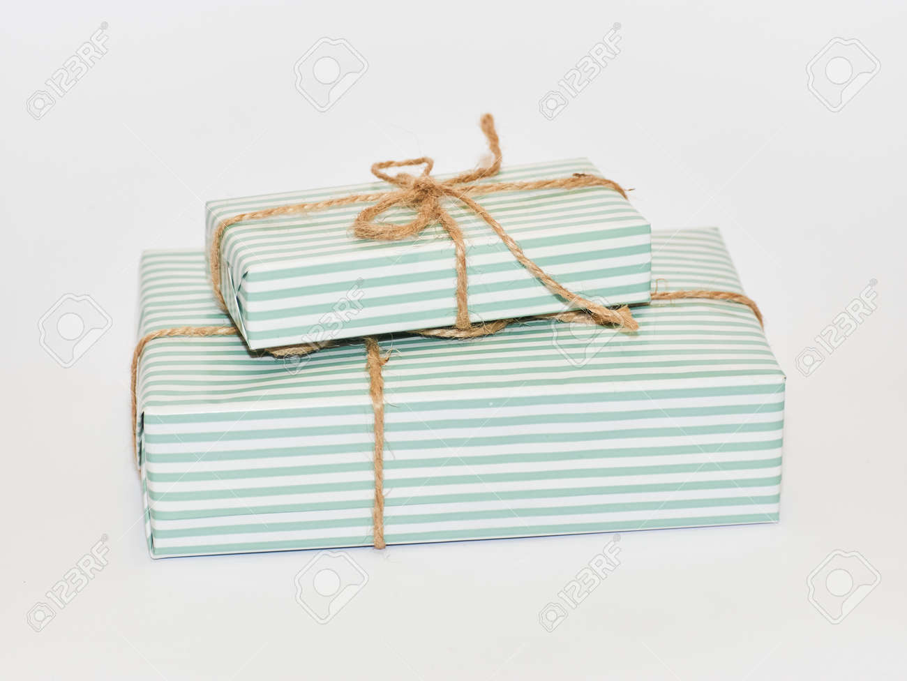 Gift Boxes Tired With Bow On White Background Layout For Delivery
