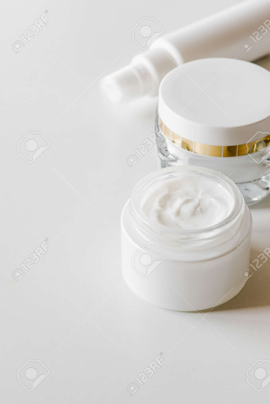 White blank cosmetic bottles, container or cream jar, serum or other cosmetic product on light background. Natural spa concept. - 152412245