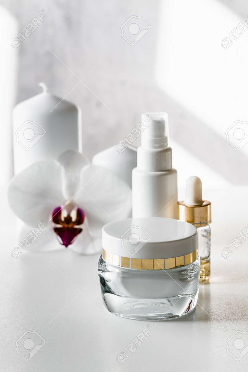 White blank cosmetic bottles, container or cream jar, serum or other cosmetic product on light background. Natural spa concept. - 152411748