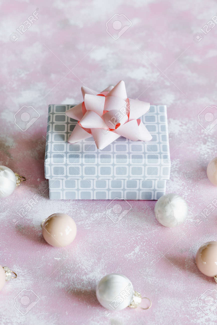 Christmas and New Year holiday background or greeting card. Gray white gift box with pink bow. - 156080786