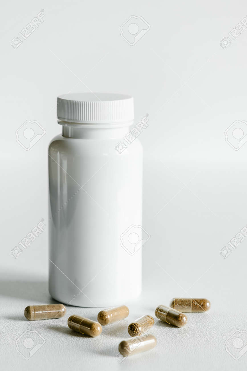 Herb capsules and white bottle, healthcare and beauty concept. - 156080793