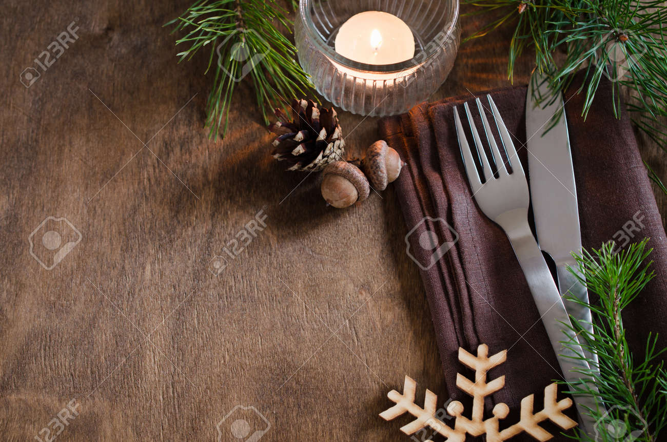 Vintage Or Rustic Christmas Table Setting With Candle And Wooden ...