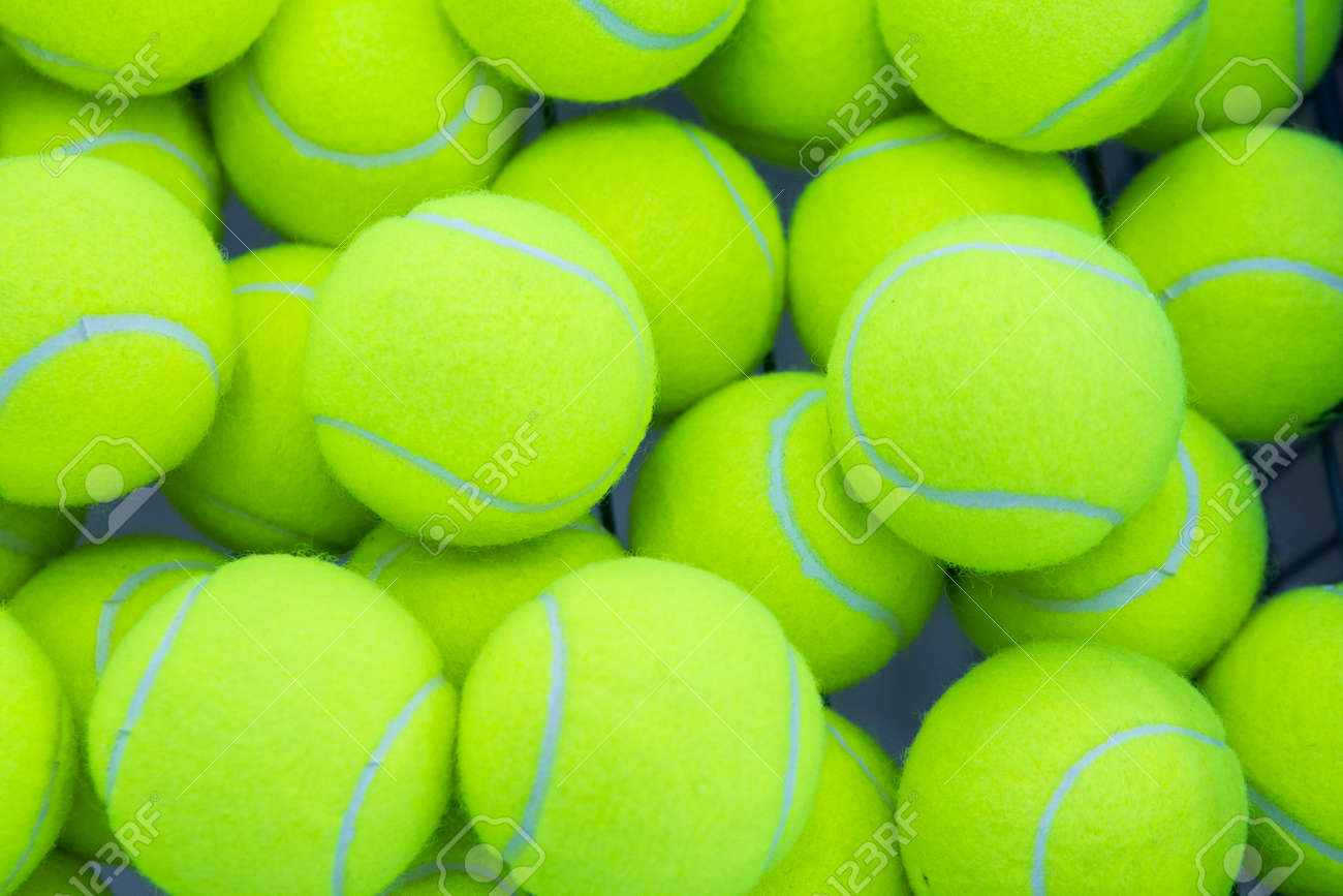 Lot Of Bright Yellow Tennis Balls As A Background Stock Photo