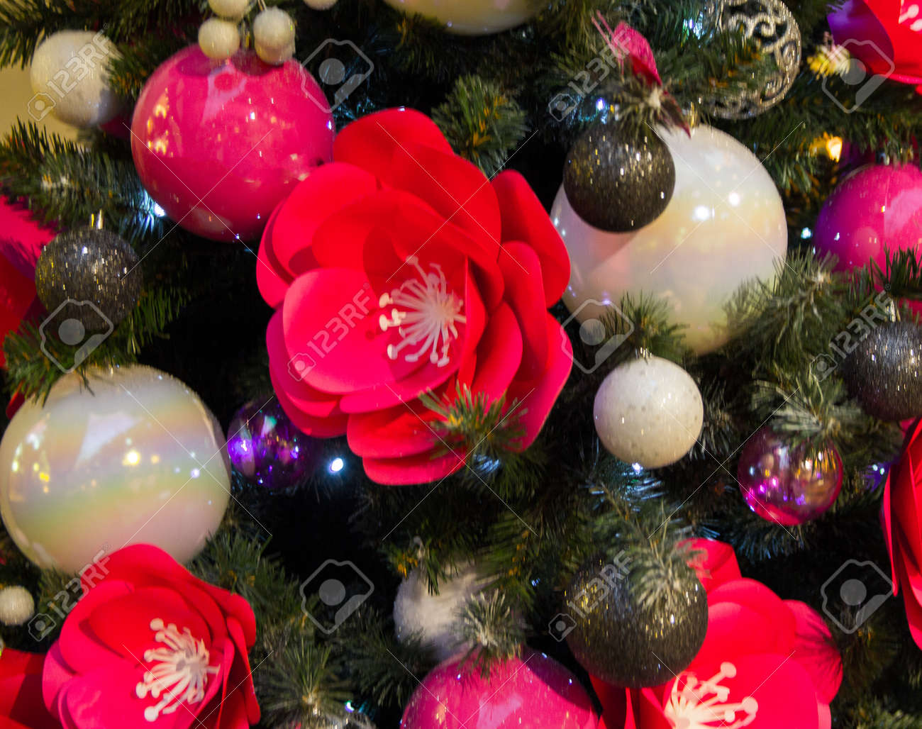 Large pink flowers and white balls on a christmas tree a substrate large pink flowers and white balls on a christmas tree a substrate stock photo mightylinksfo