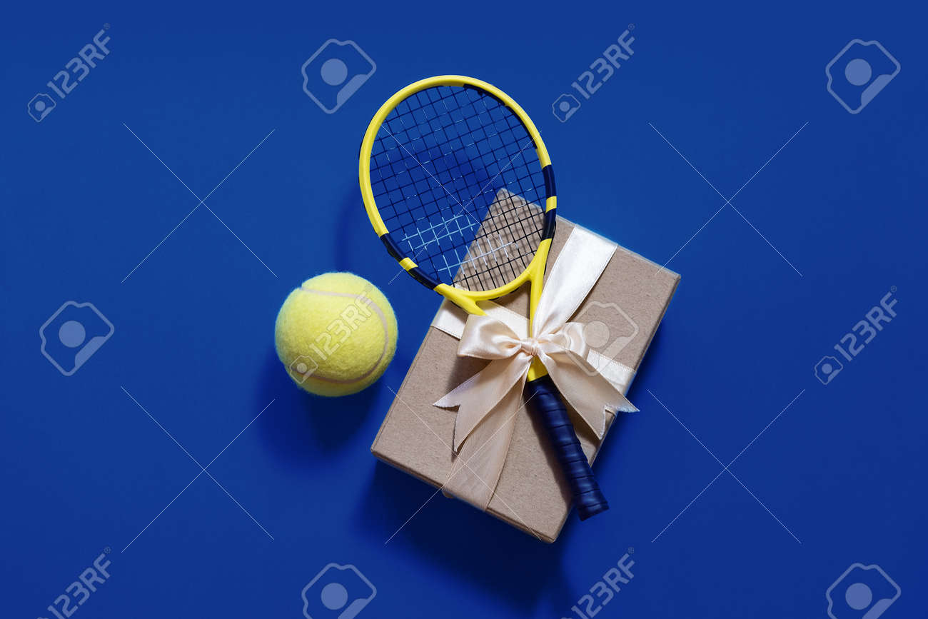 Tennis Love Layout Tennis Balls And Racket In Gift Box With Ribbon.. Stock  Photo, Picture And Royalty Free Image. Image 136759707.