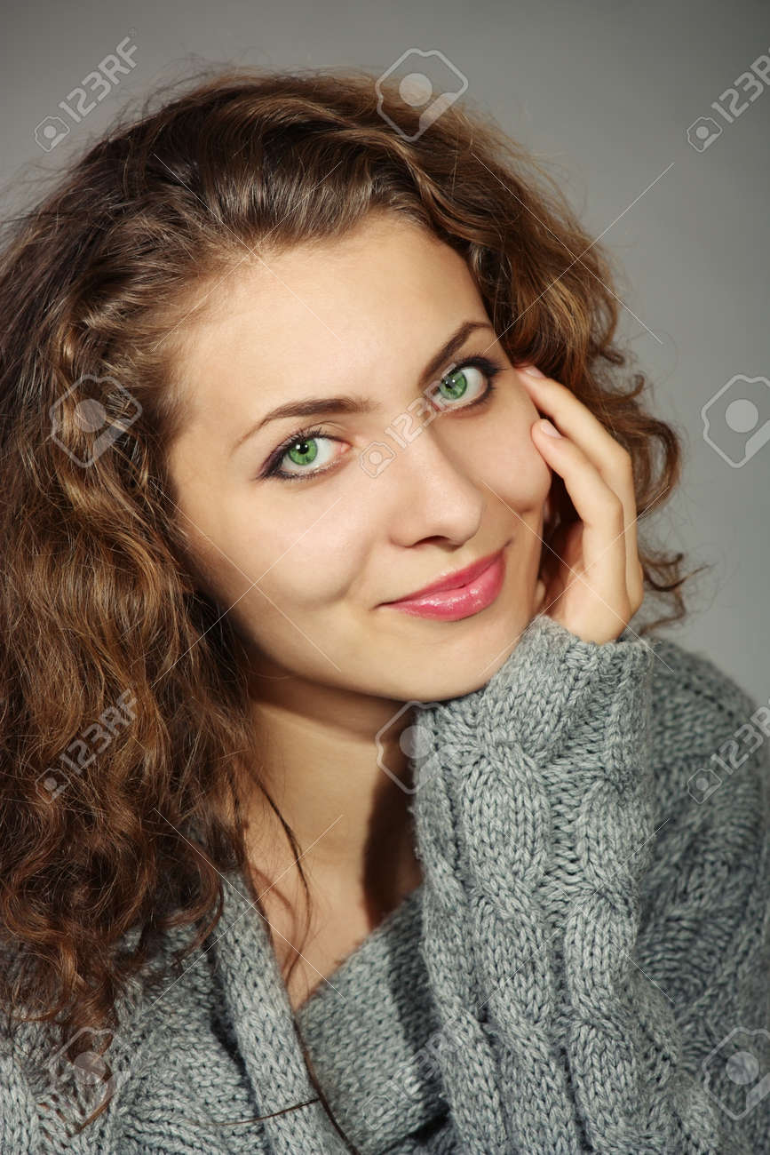 Portrait. Beautiful young woman in a gray sweater with a gray background Stock Photo - 11746895