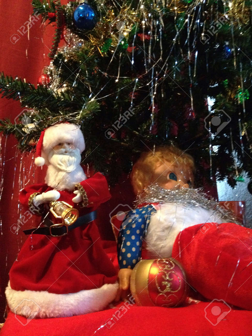 The Christmas Clause.Santa Clause Leaving A Toy Under The Tree For Christmas